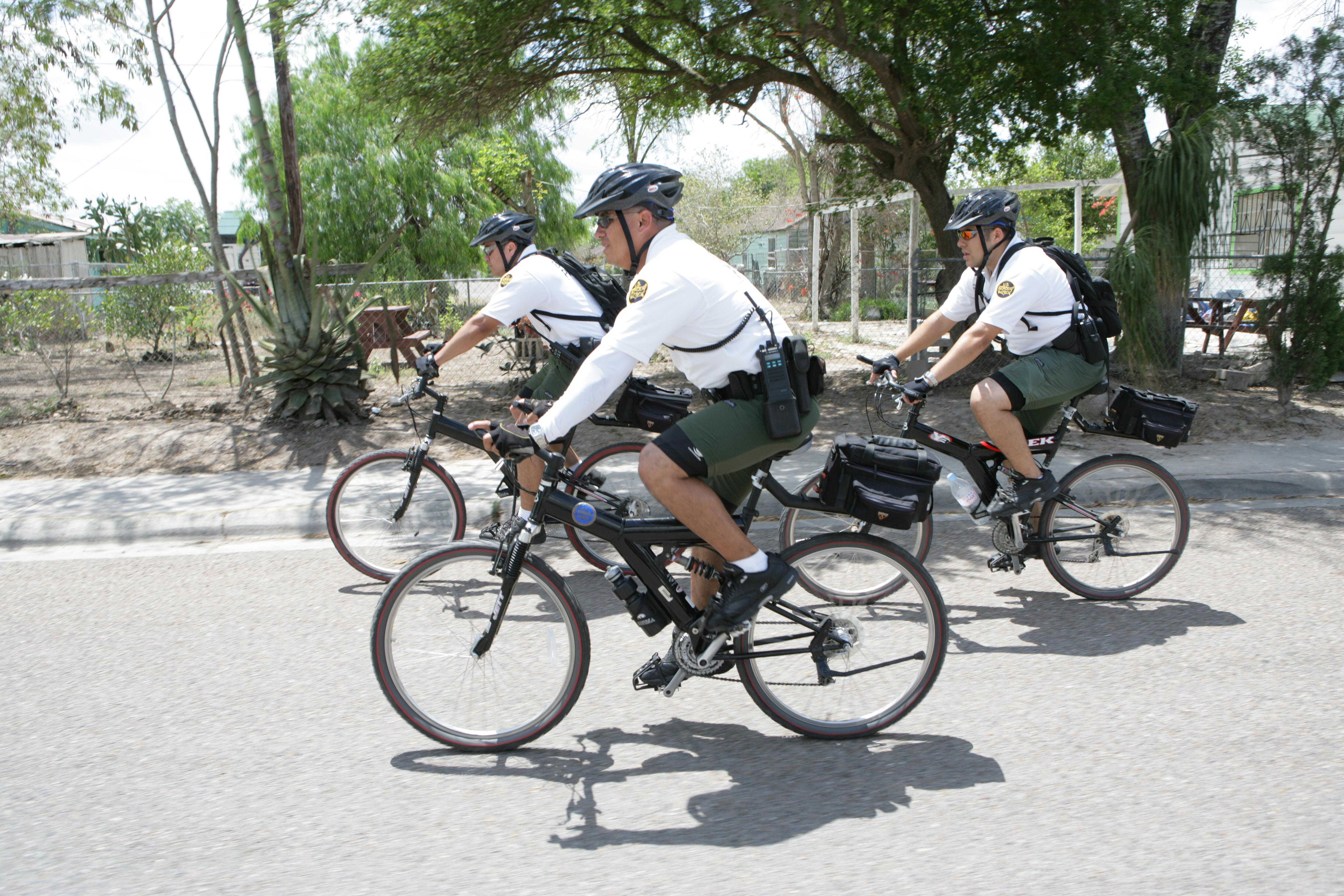United States Border Patrol bicycle units patrol the city of Brownsville, Texas looking for illegal Immigrants.