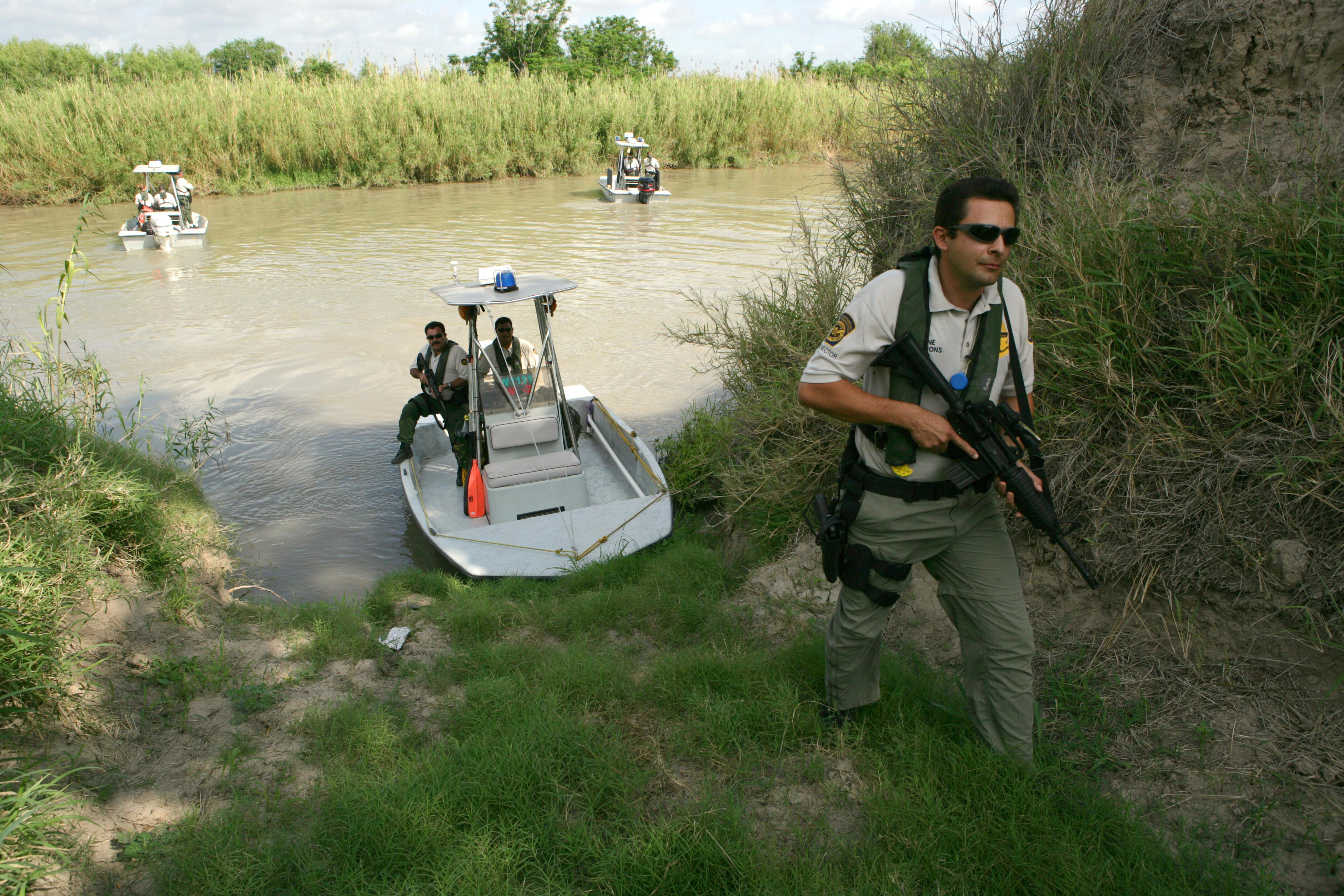 A CBP Border Patrol Agent investigates a potential landing area for illegal immigrants along the Rio Grande River in Texas.