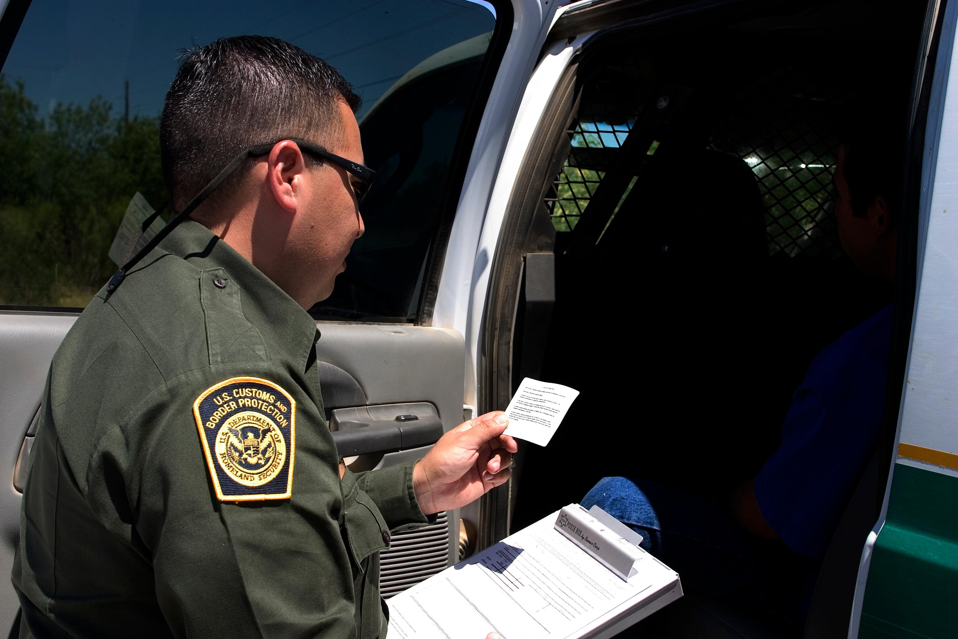U.S. Border Patrol agent reads the Miranda rights to a Mexican national arrested for transporting drugs.