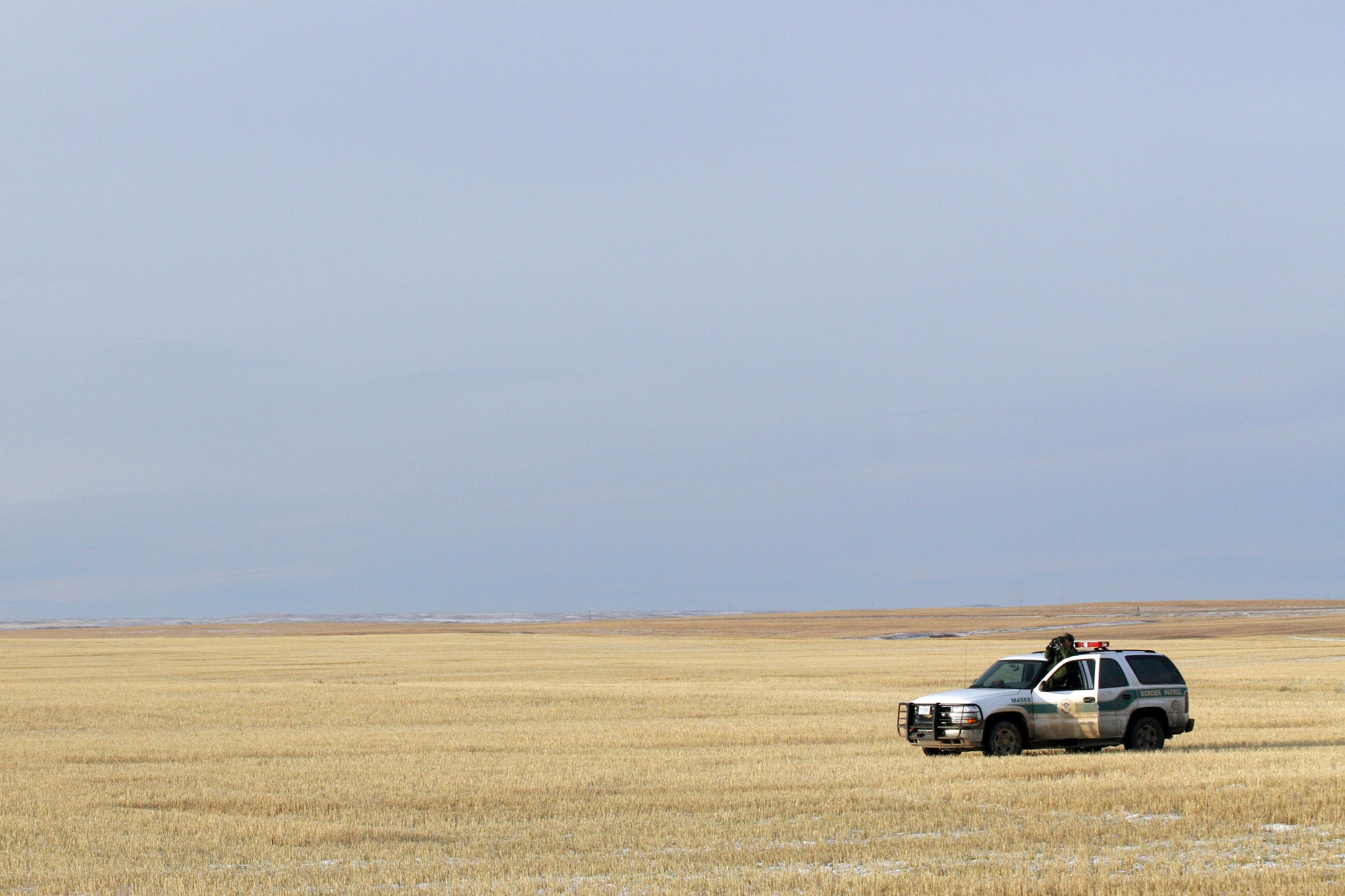 CBP Border Patrol agent monitors US/Canadian border near Sweet Grass Montana.