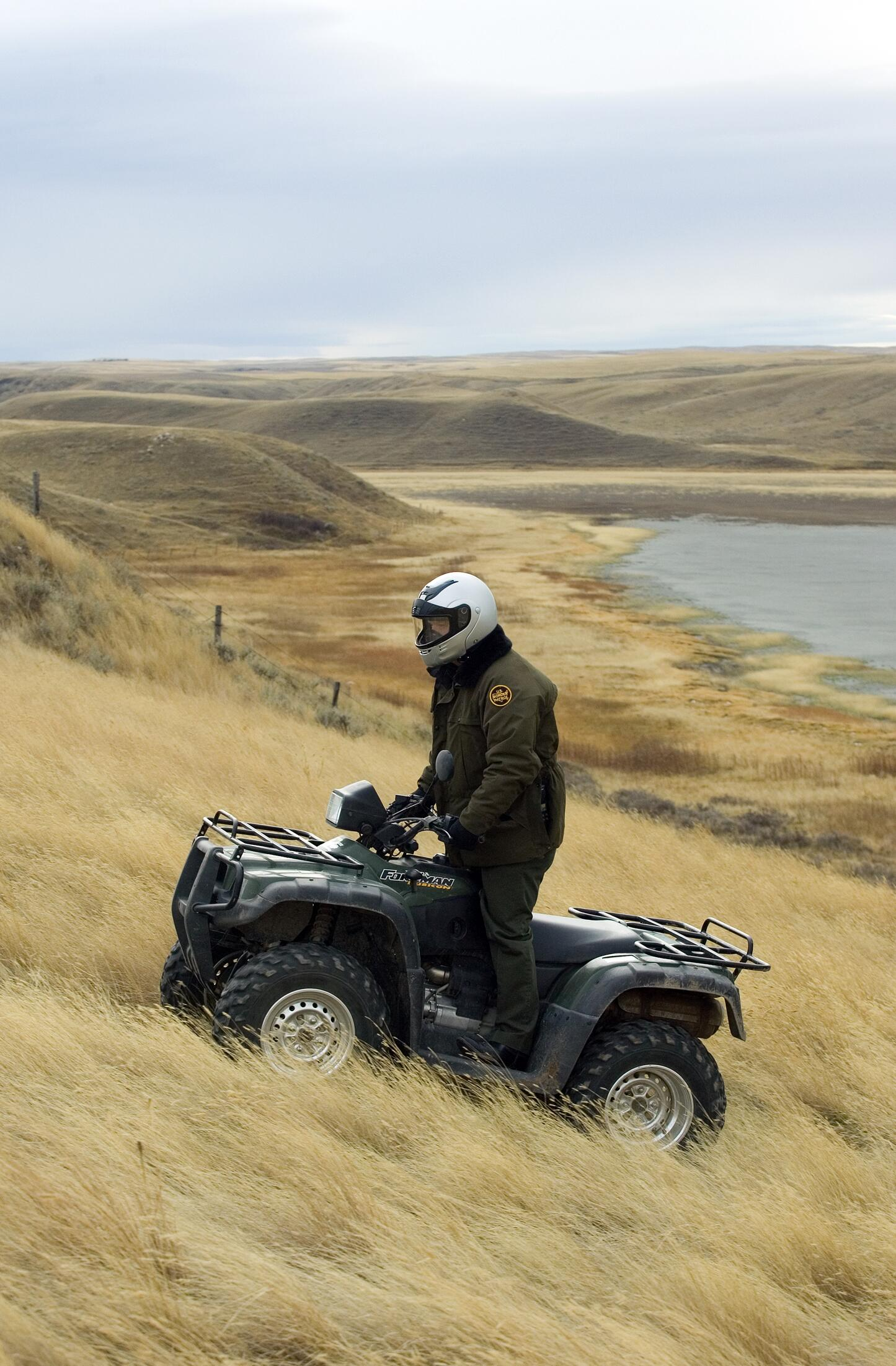 Border Patrol agent uses All Terrain Vehicle to conduct routine patrols near the US/Canadian border near Sweet Grass Montana.