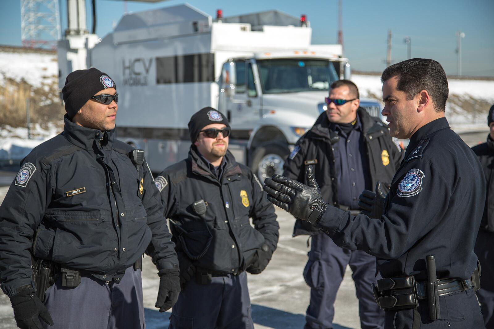 Robert Perez, director of New York area port operations and coordinator of CBP's security support for Super Bowl XLVIII, discusses deployment of high-tech scanning equipment at the stadium. CBP provided scanning of all incoming trucks and air support for the big game. <em>(photo by Josh Denmark)</em>