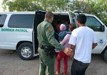 Agents escorting illegal aliens