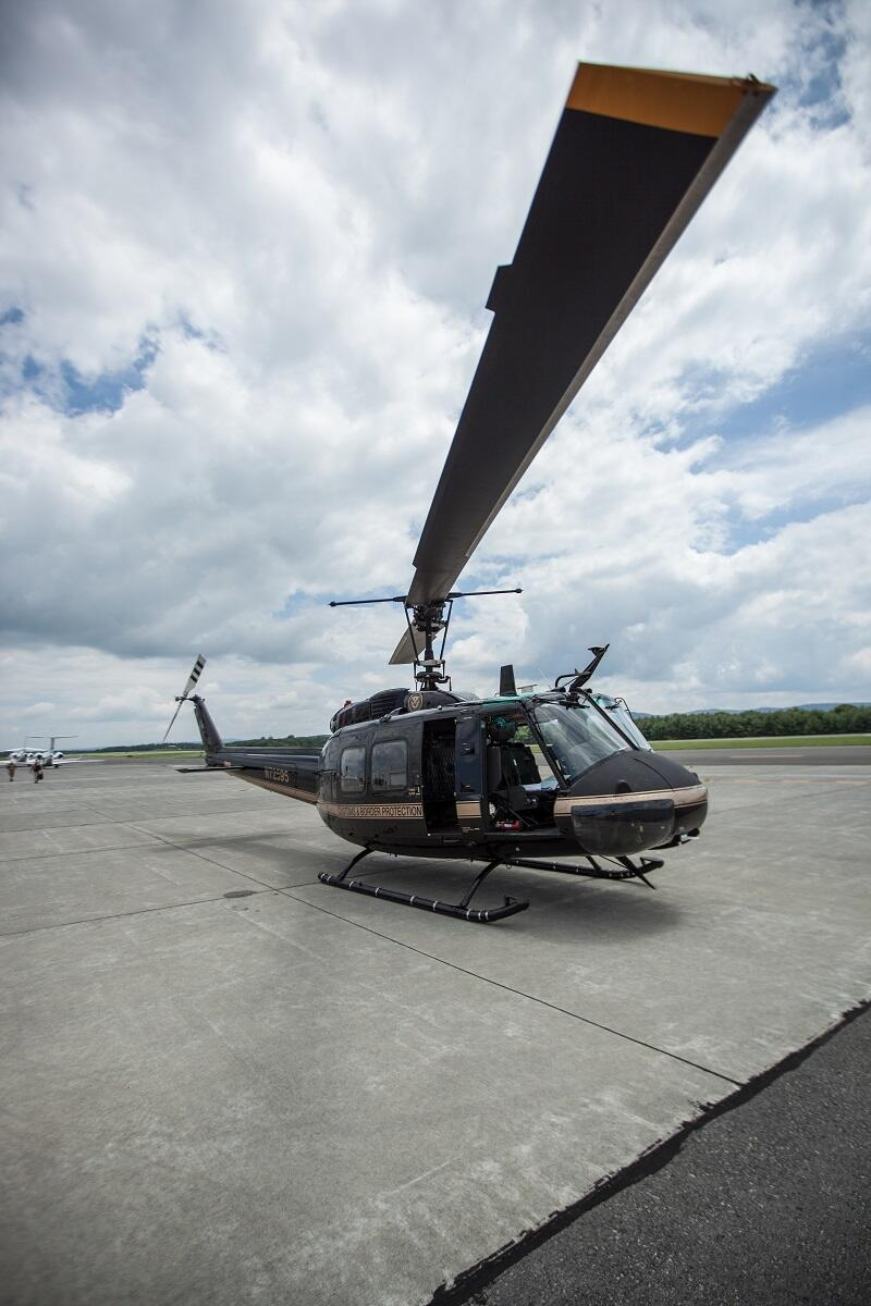 A CBP Bell Huey II readies for takeoff.<em> (photo by Josh Denmark)</em>