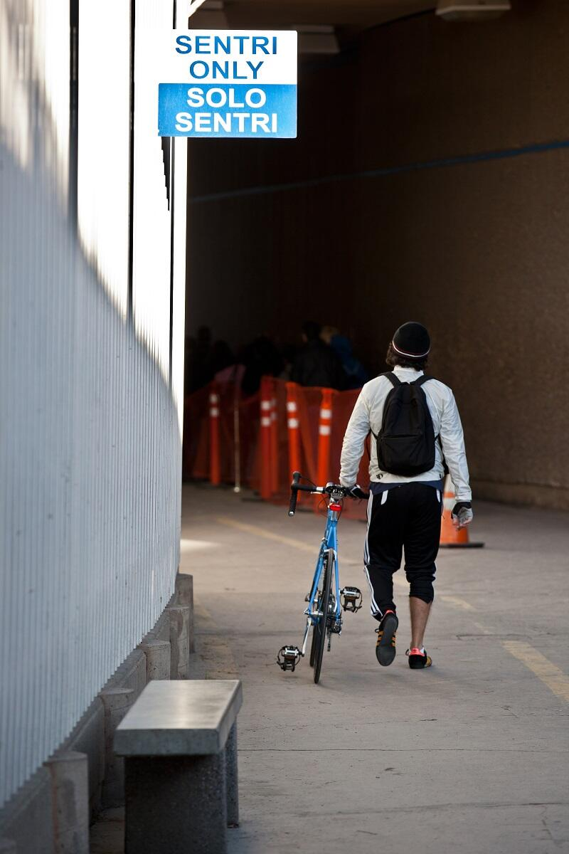 Bicyclist prepares to enter the dedicated SENTRI lane for frequent crossers at San Ysidro, Calif. port of entry.<em> (photo by Josh Denmark)</em>