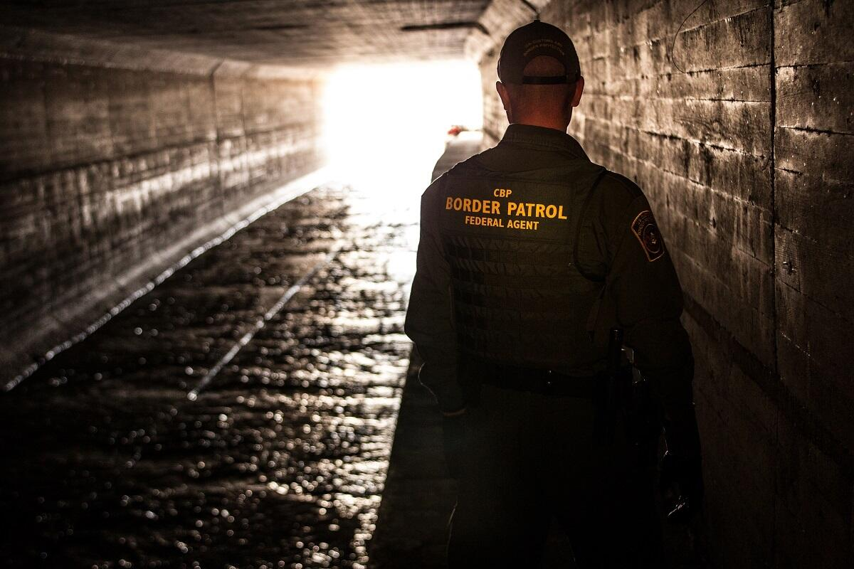 Border Patrol agent inspects a water drainage tunnel that spans from Nogales, Ariz. into Mexcio.<em> (photo by Josh Denmark)</em>
