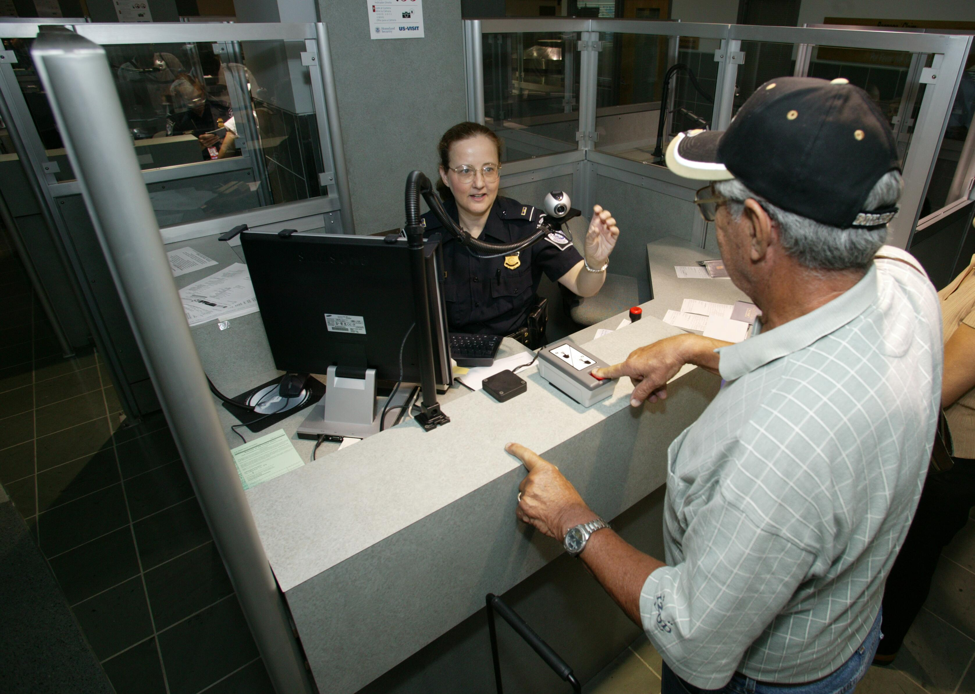 A CBP Officer uses new technologies to process passengers.