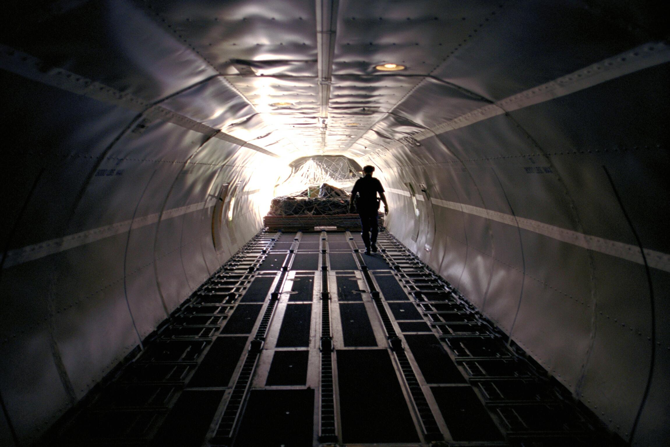 A CBP Officer examines the last bit of cargo to be off loaded from an aircraft.