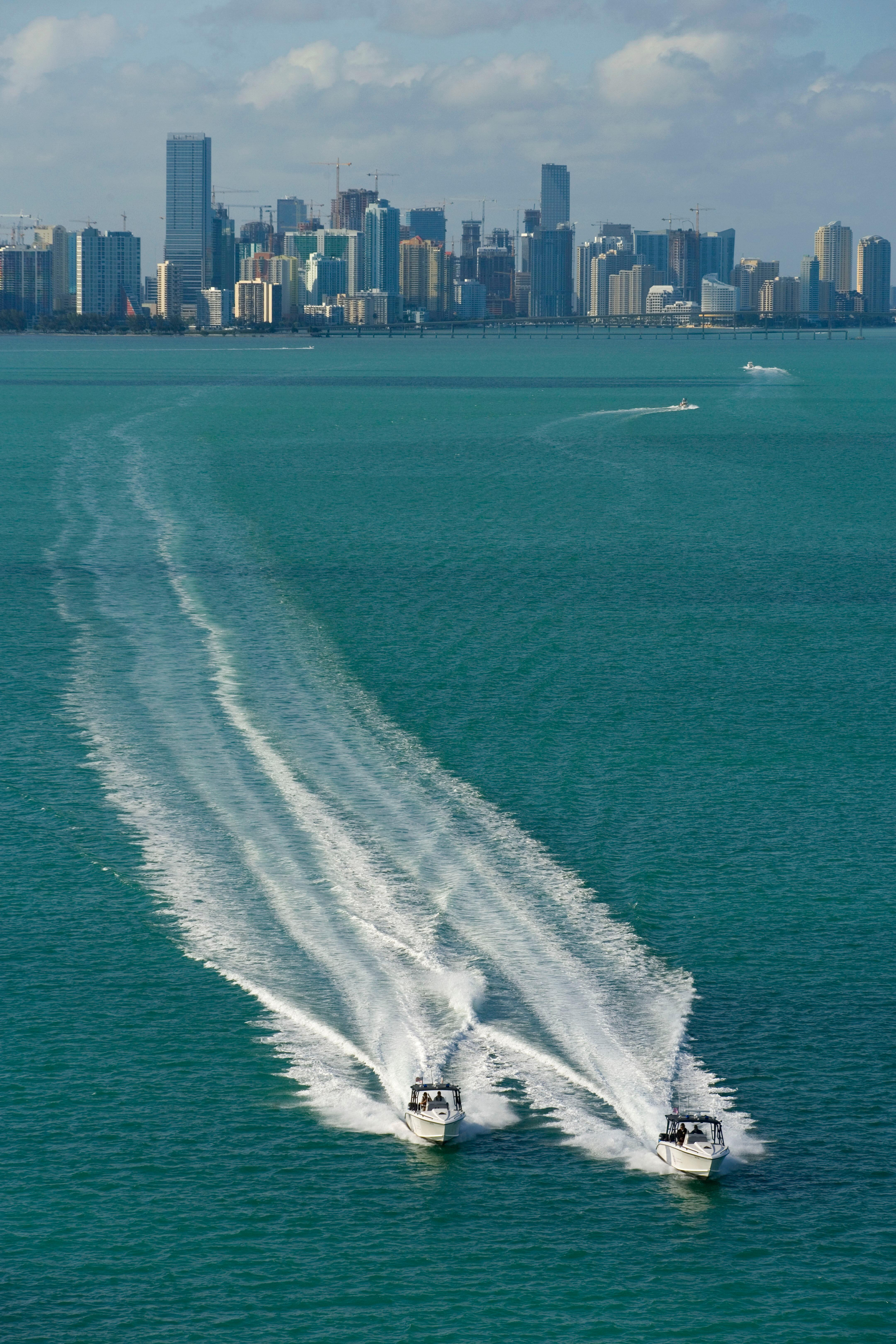 Two CBP marine unit Midnight Express boats patrol the waters off Miami.