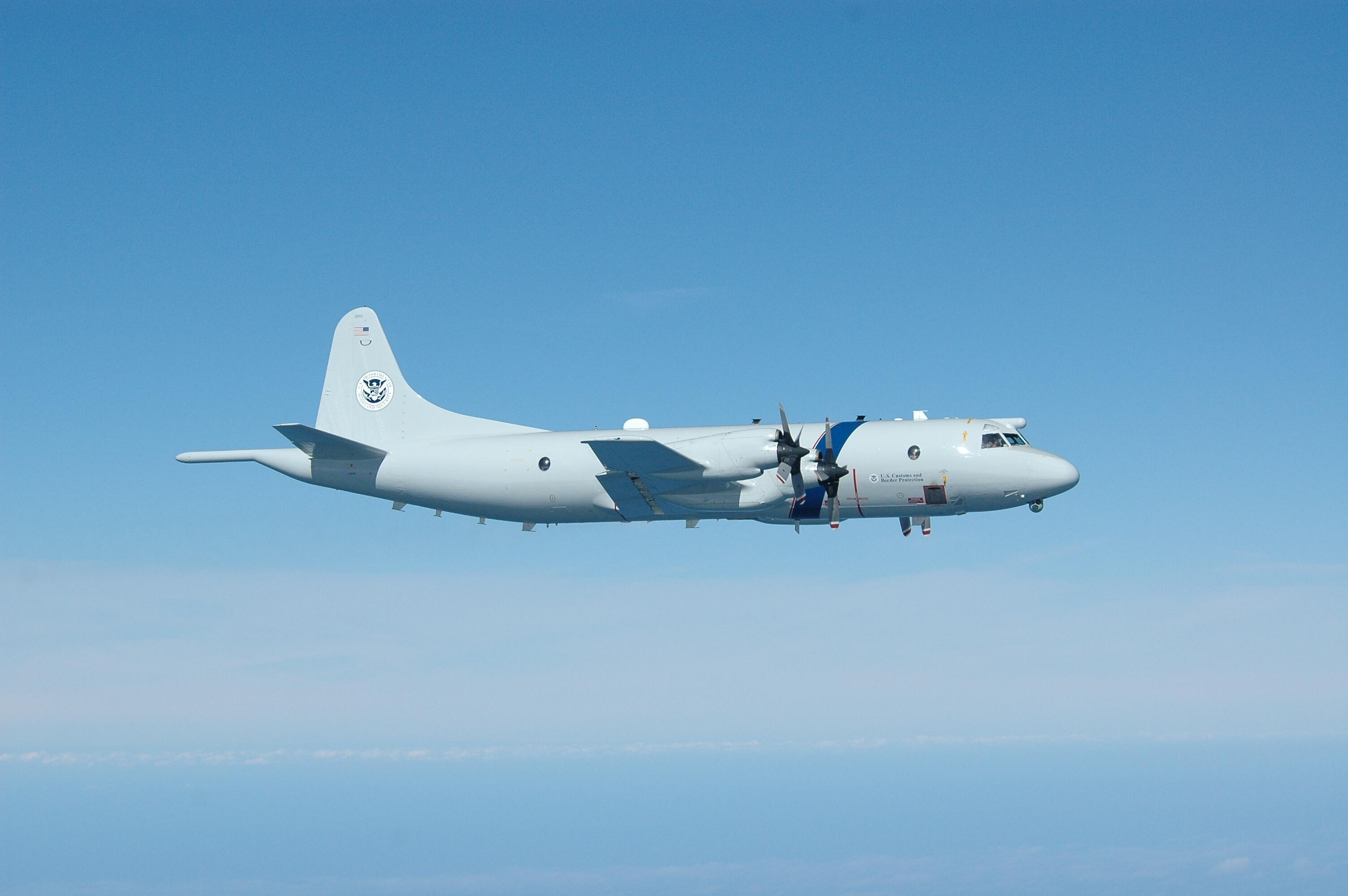 The P-3 Long Range Tracker Aircraft detects and tracks multiple targets and the accompanying aircraft intercepts, identifies and tracks those suspect targets.