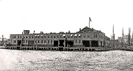 Boston's Long Wharf immigrant station (second floor) & freight shed, circa 1904. The roofline of the Custom House Block is visible at the right end of the station.