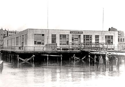 East Boston Immigration Station. 1922 view from Boston Harbor, before second story was added and the landing pier relocated.