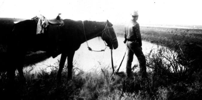 Patrol Inspector Albert Blakeway on horse patrol of border near Indio, Texas - 1942.