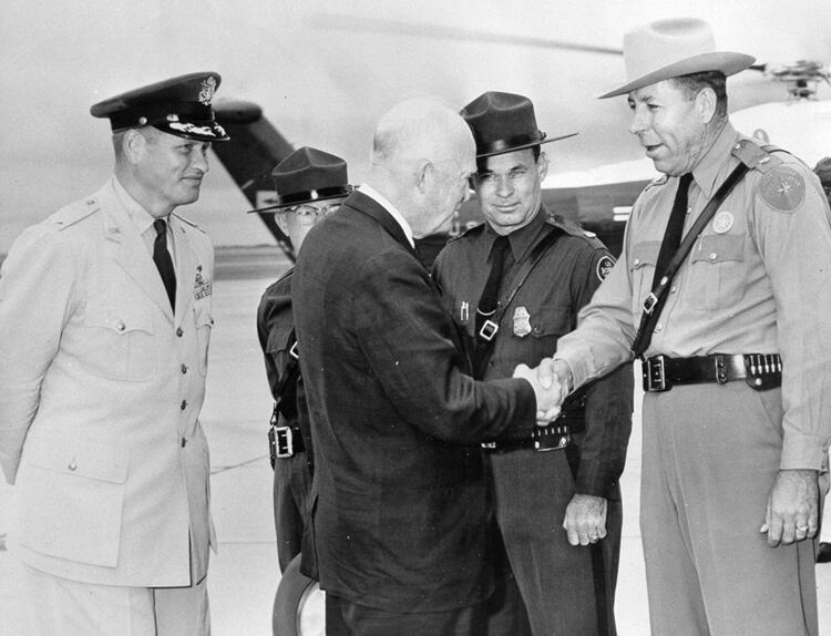 President Dwight D. Eisenhower greeting (left to right) Chief Border Patrol Inspector Edwin Dorn, Border Patrol Special Detail Officer Glenn L. Weatherman, and Texas Department of Public Safety Major Spiers on his visit to Del Rio, Texas, Oct. 24, 1960.