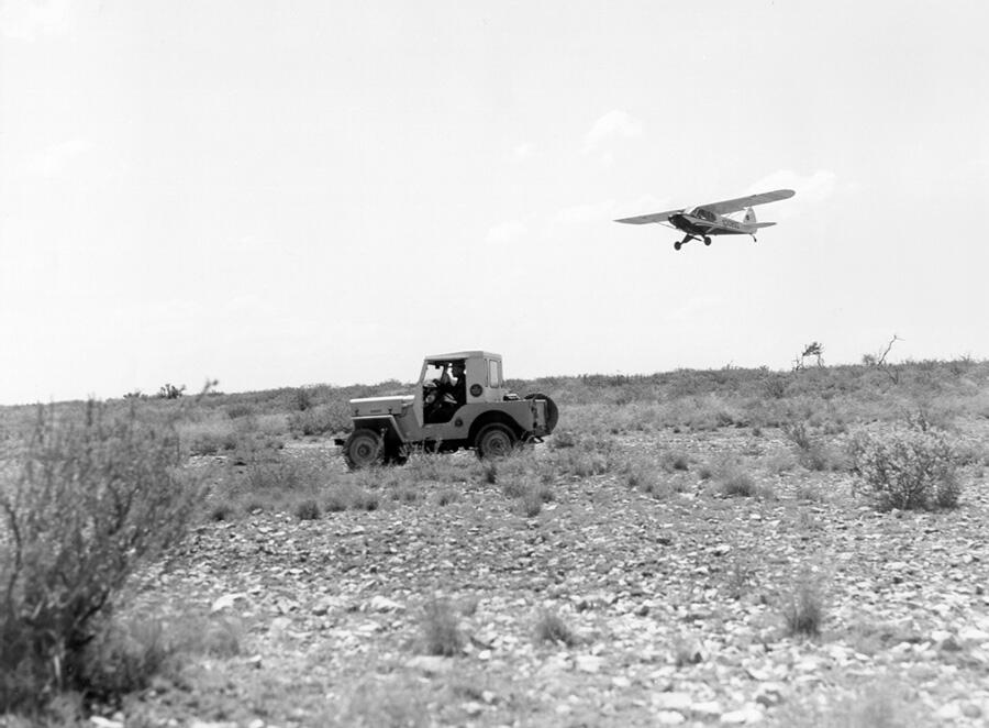 Ground crews working with Del Rio Sector aircraft in search for illegal immigrants in early 1960s.