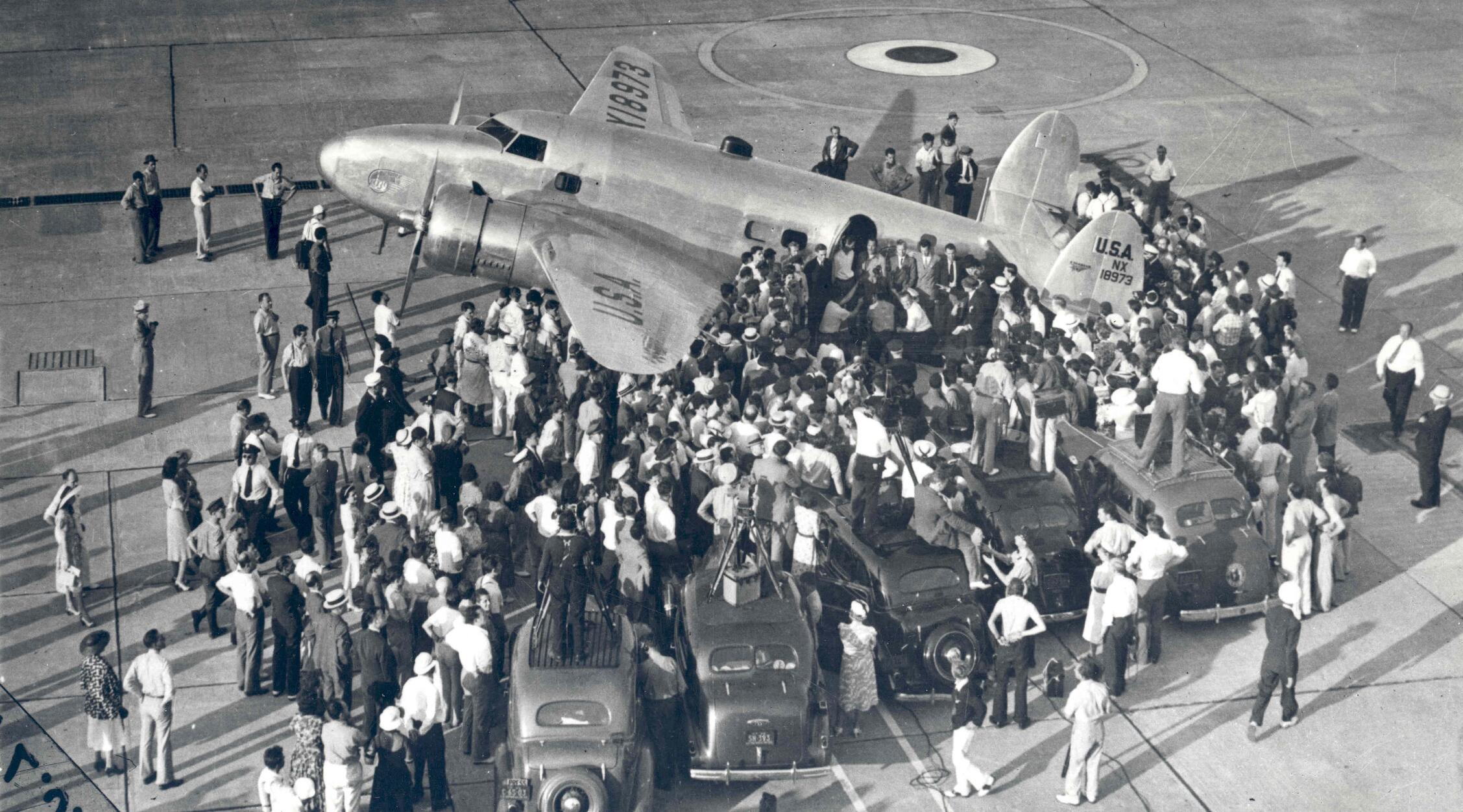 Floyd Bennett Field on Long Island, New York, was a site where one record after another was set and broken in rapid succession during the golden era of aviation between the two world wars. In this photograph, Hughes and his crew prepare to set out for Paris from the Field on the first leg of their tour. Their 91-hour adventure generated publicity for the World's Fair, set to open the following year -- and made Howard Hughes an international celebrity.