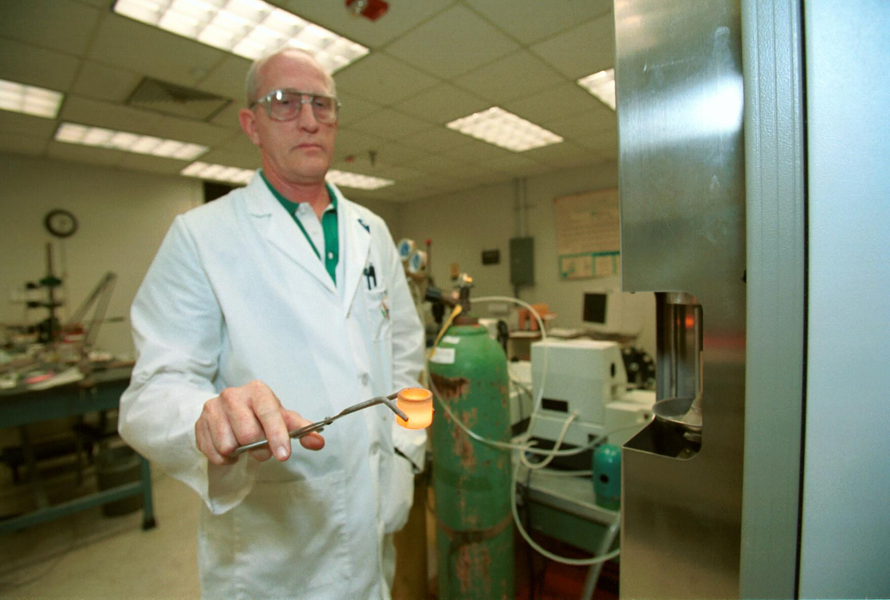 A CBP scientist runs extensive tests on a metal sample to determine its' origin.
