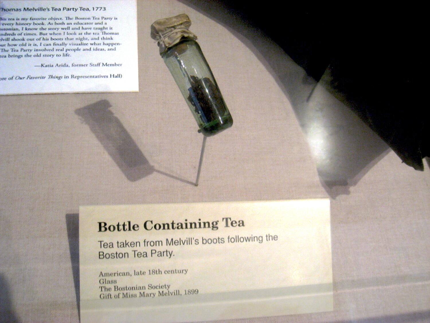 Bottle containing the tea Thomas Melvill found in his boots after the Boston Tea Party in 1773. The Tea Party participants went to great lengths to ensure no one kept any of the precious tea. When Melvill returned to his home he discovered there were tea leaves in his boots, and so he placed the leaves in a vial and surreptitiously held them for the remainder of his life. Handed down in the Melvill family, the leaves were donated to Boston's Old State House Museum in 1899 by a descendent, Miss Mary Melvill.
