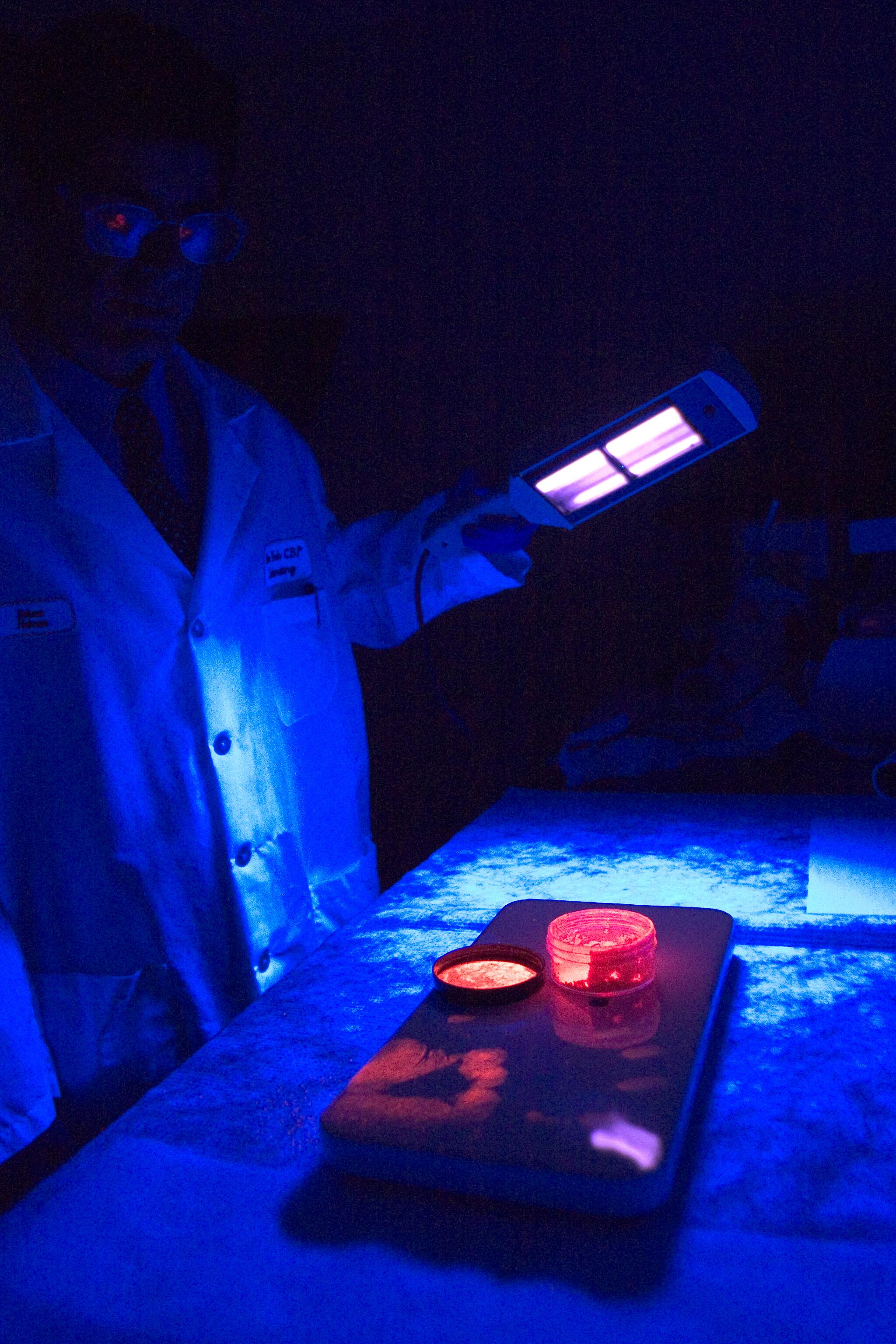 CBP Laboratory personnel apply ultraviolet light to see things not ordinarily visible to the naked eye.