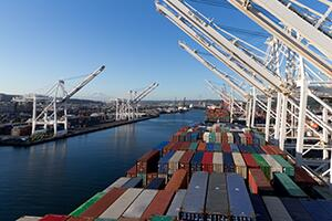 During the coronavirus pandemic, the U.S. borders have remained open for legitimate trade. Above, maritime cargo containers stretch the expanse of the docks at the port of Seattle.   Photo by Jerald Glaser, CBP file photo