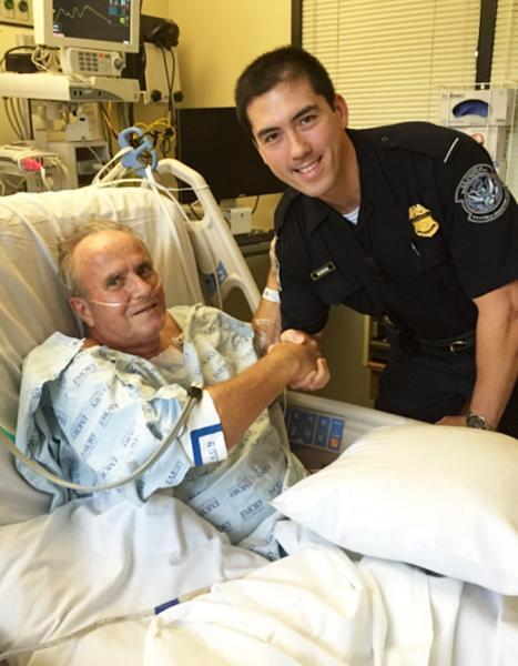 Florida heart attack victim John Heilig thanks CBP Officer John Seebode at Emory University Hospital in Atlanta. CBPO Seebode helped save Heilig's life after he collapsed upon arrival at Hartsfield-Jackson Atlanta International Airport from Japan last December.
