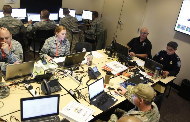 Photo of JTAC members working around a desk