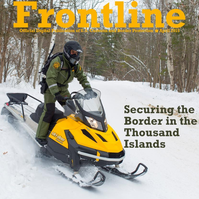 Photo of a Border Patrol agent on a snowmobile