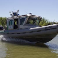 Photo of a Border Patrol boat on patrol on the Rio Grande River