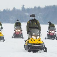 Photo of agents on snowmobiles on the St. Lawrence River.