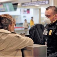 An officer with a traveler at a Preclearance facility