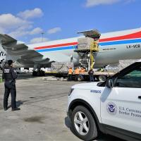 CBP Officer watches air cargo unload