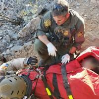 Arizona Department of Public Safety officer, above left, assists a Border Patrol agent with a medical extraction in Arizona