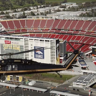 Photo of a CBP Blackhawk above Levi's Stadium, site of Super Bowl 50