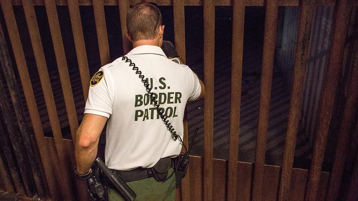 Photo of Border Patrol agent inspecting drainage gates