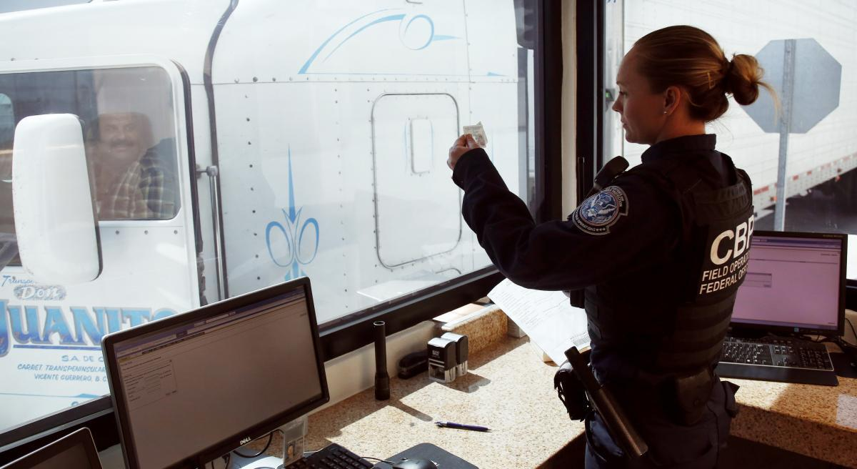 CBP officer Jennifer Krismer verifies a driver's credentials