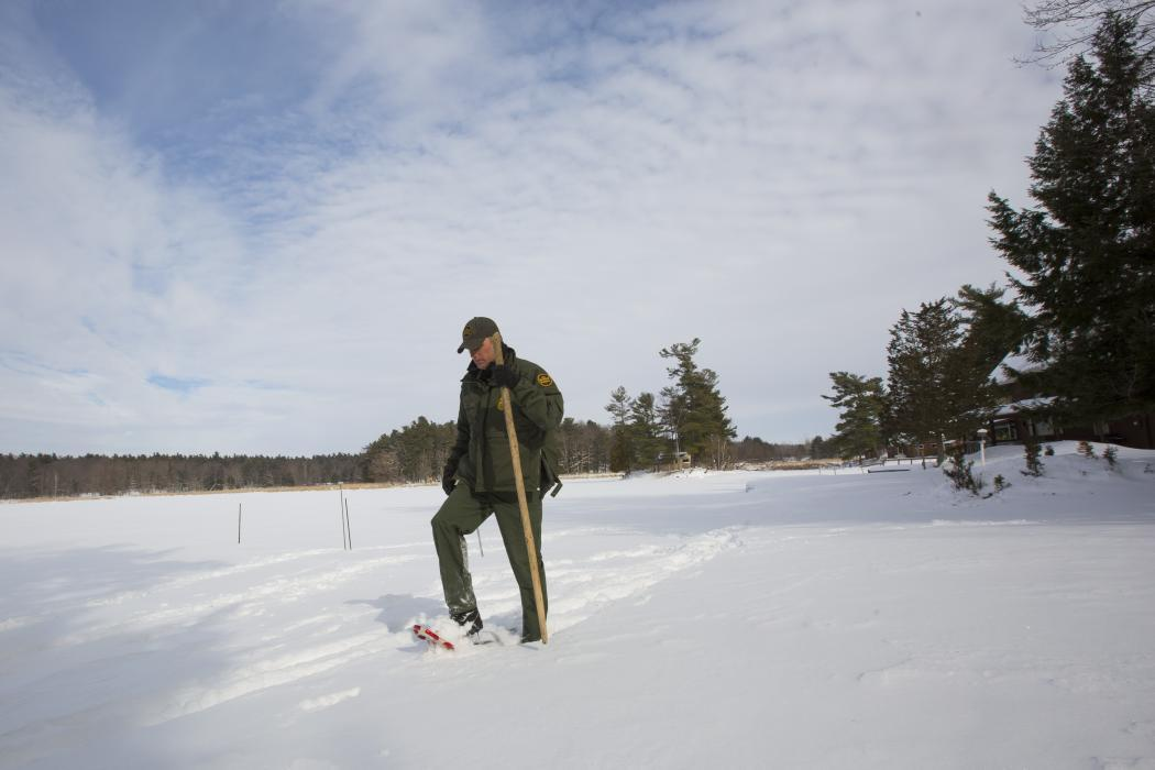 Photo of a Border Patrol agent on a remote patrol using snowshoes.