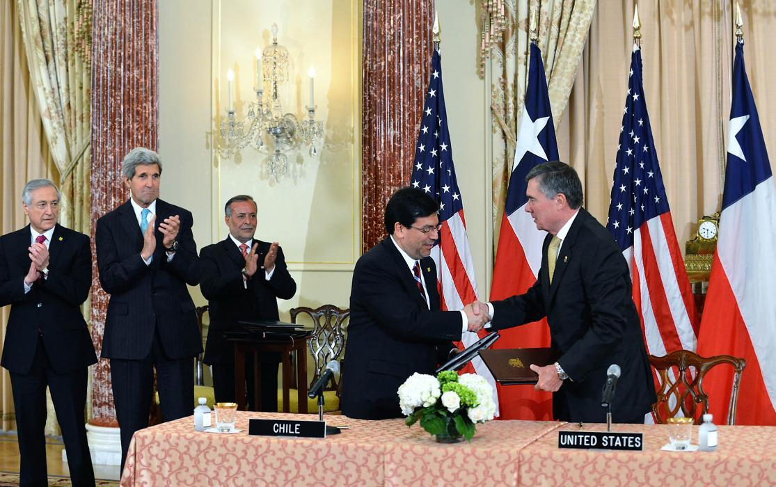 Photo of Kerlikowske with Chile Finance Minister Alberto Arenas at a June signing of a customs mutual assistance agreement.
