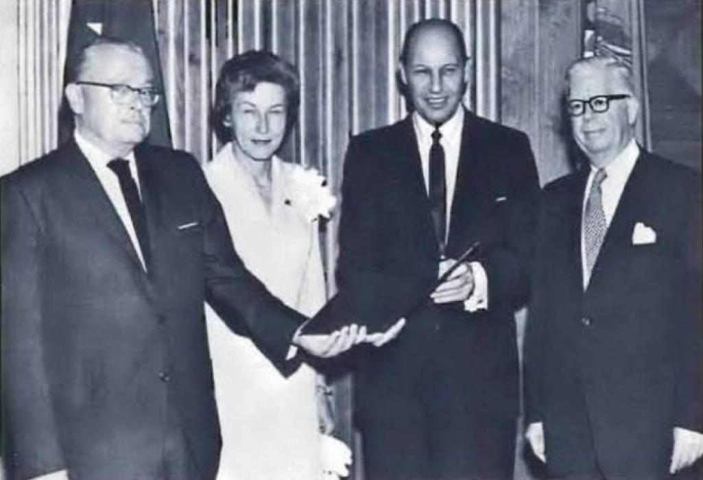 Photo of Commissioner Lester D. Johnson receiving the Treasury's Exceptional Service Award from Secretary Henry H. Fowler