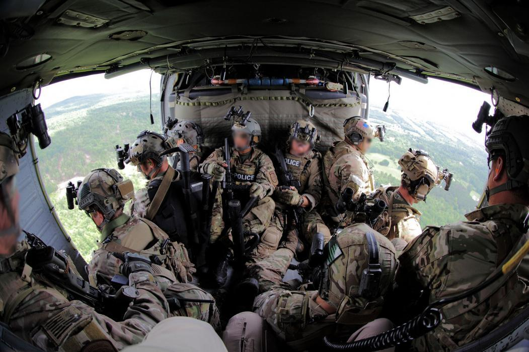 Photo of a search team in a Black Hawk helicopter