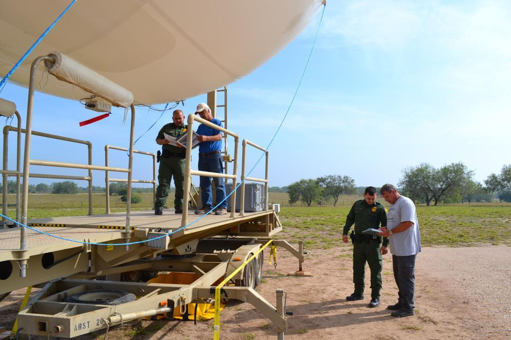 Photo of Border Patrol agents preparing tactical aerostat for launch in Rio Grande Valley, Texas.