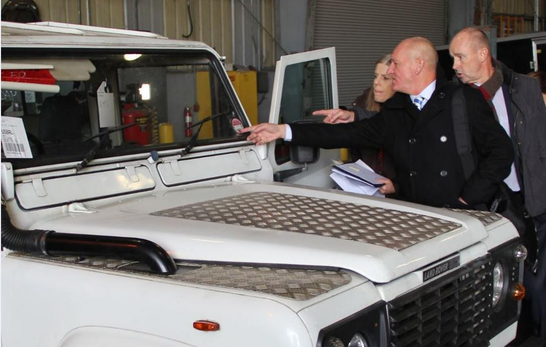 Photo of Operation Atlantic partners examining a Land Rover Defender