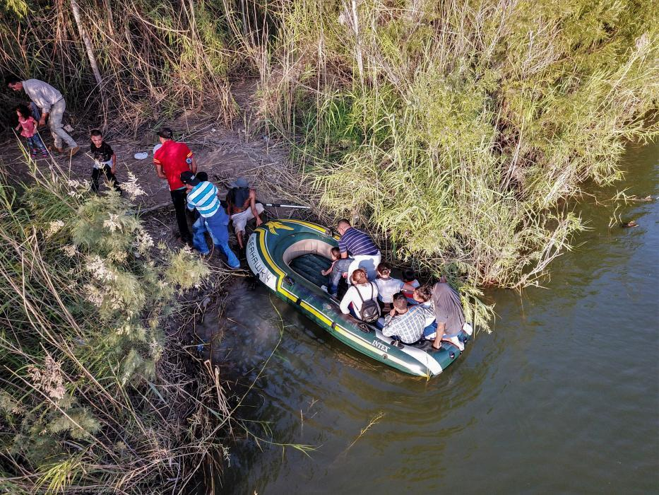 A group of illegal aliens use a raft to enter the United States