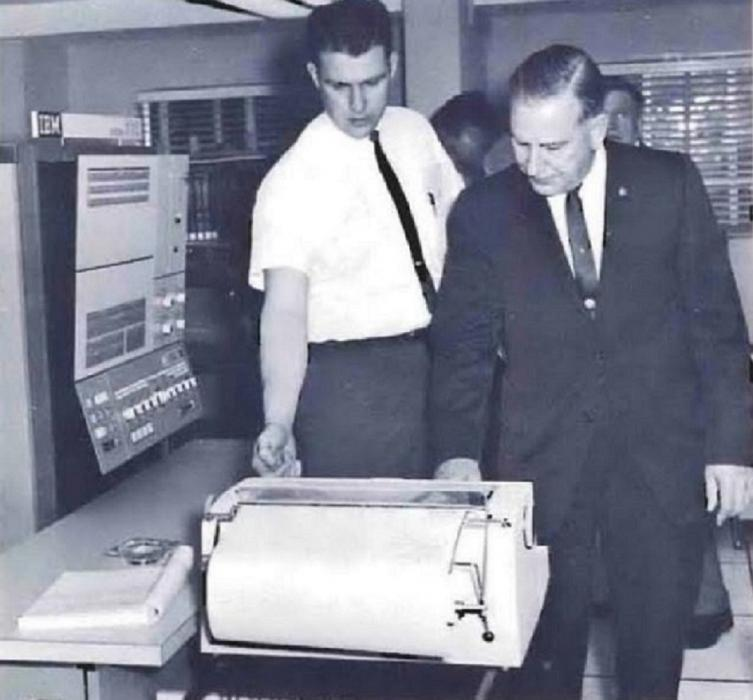 Photo of U.S. Customs Assistant Commissioner Norbert Strub witnessing a demonstration of the agency's new IBM computer system.