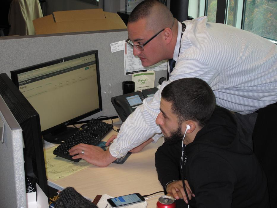 Photo of CBP employees discussing cybersecurity