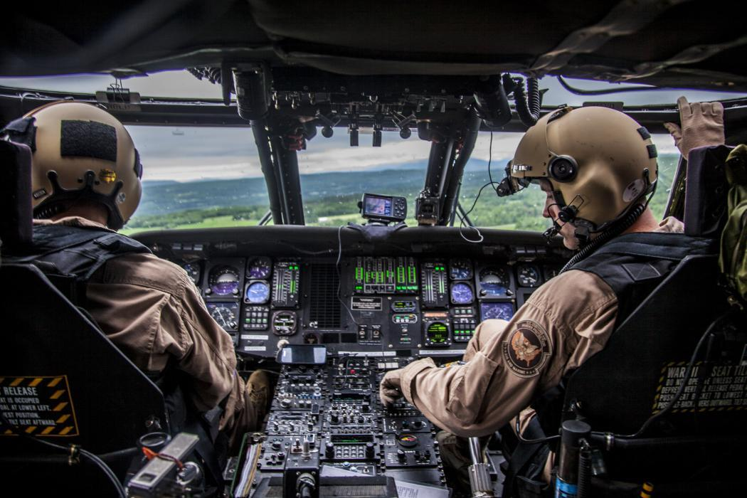 Photo of Air and Marine pilots in a helipcopter