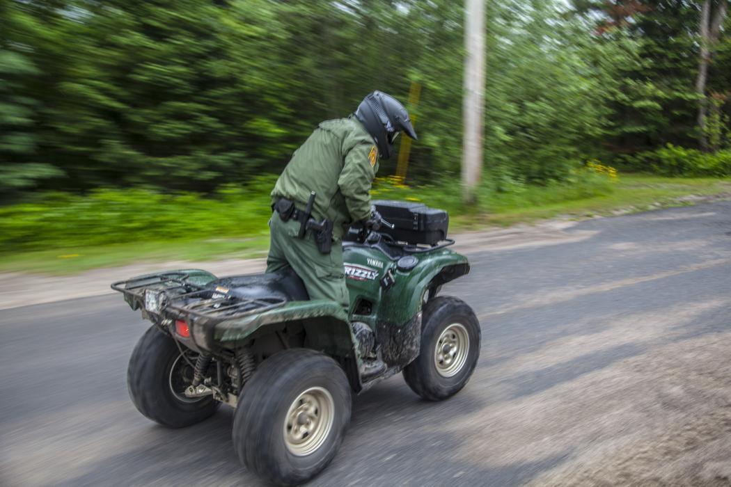Photo of a Border Patrol agent on an ATV