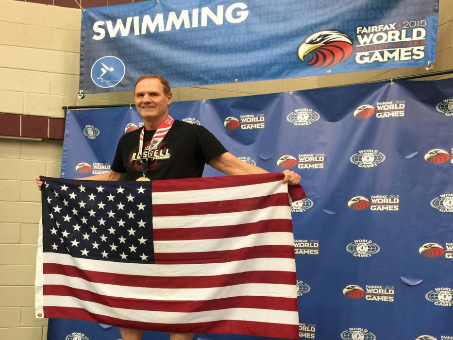 Photo of CBP swimmer from Denver on the award stand
