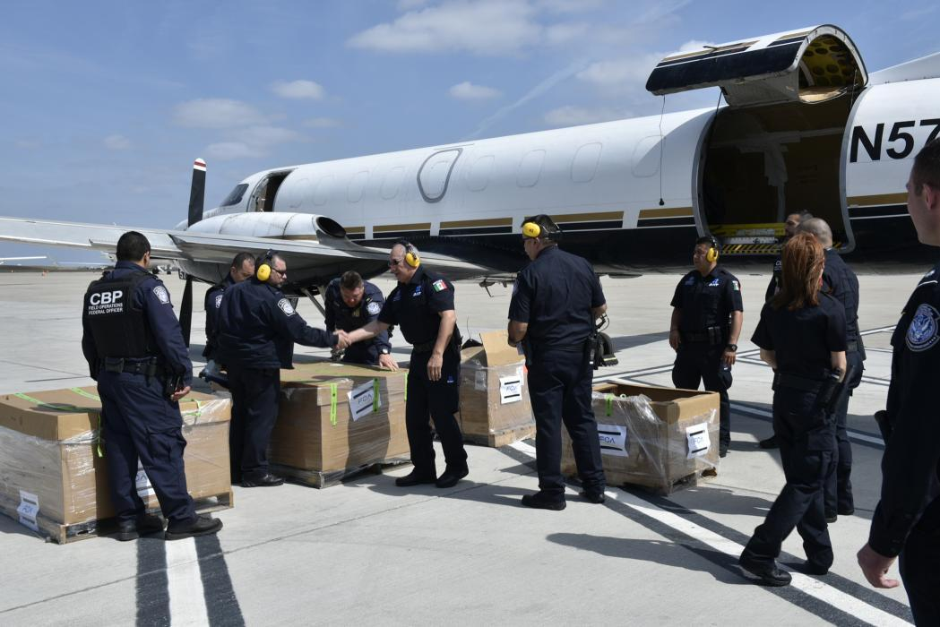 CBP officers onspect a shipment before the flight continues