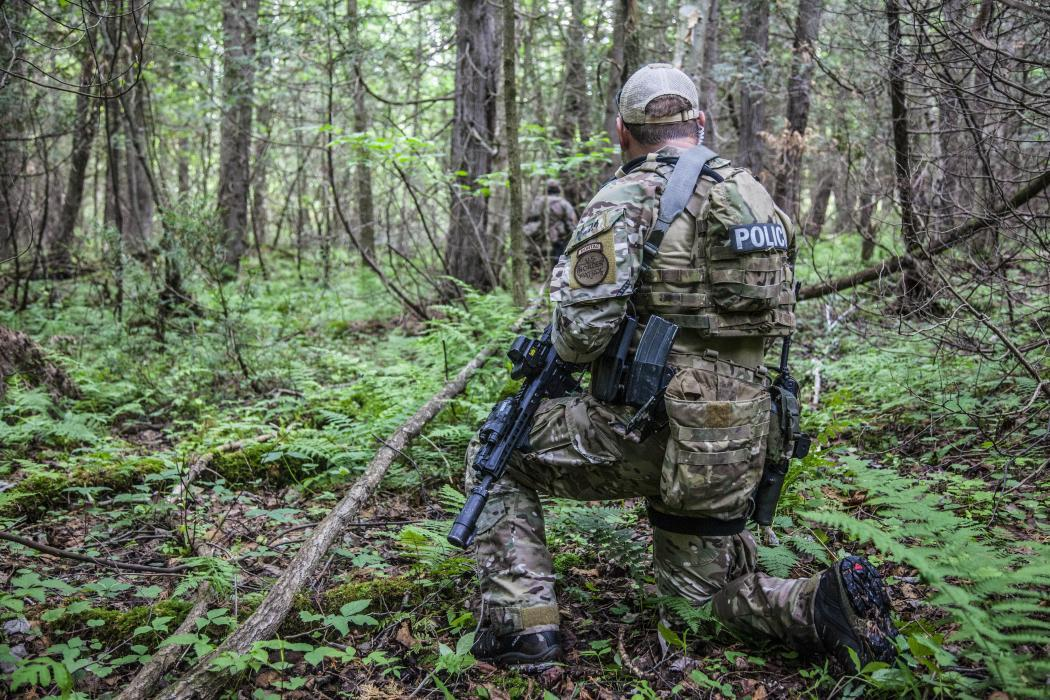 Photo of Bortac agent in the woods during the New York manhunt