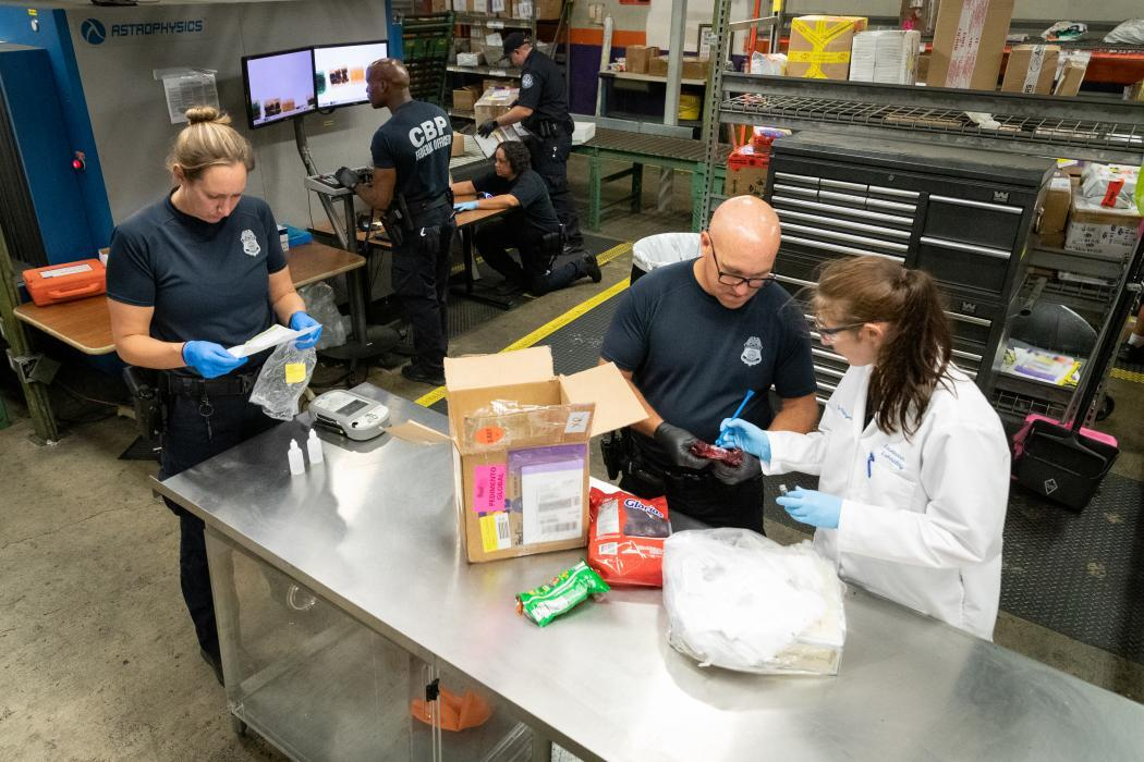 CBP employees work in a triage area